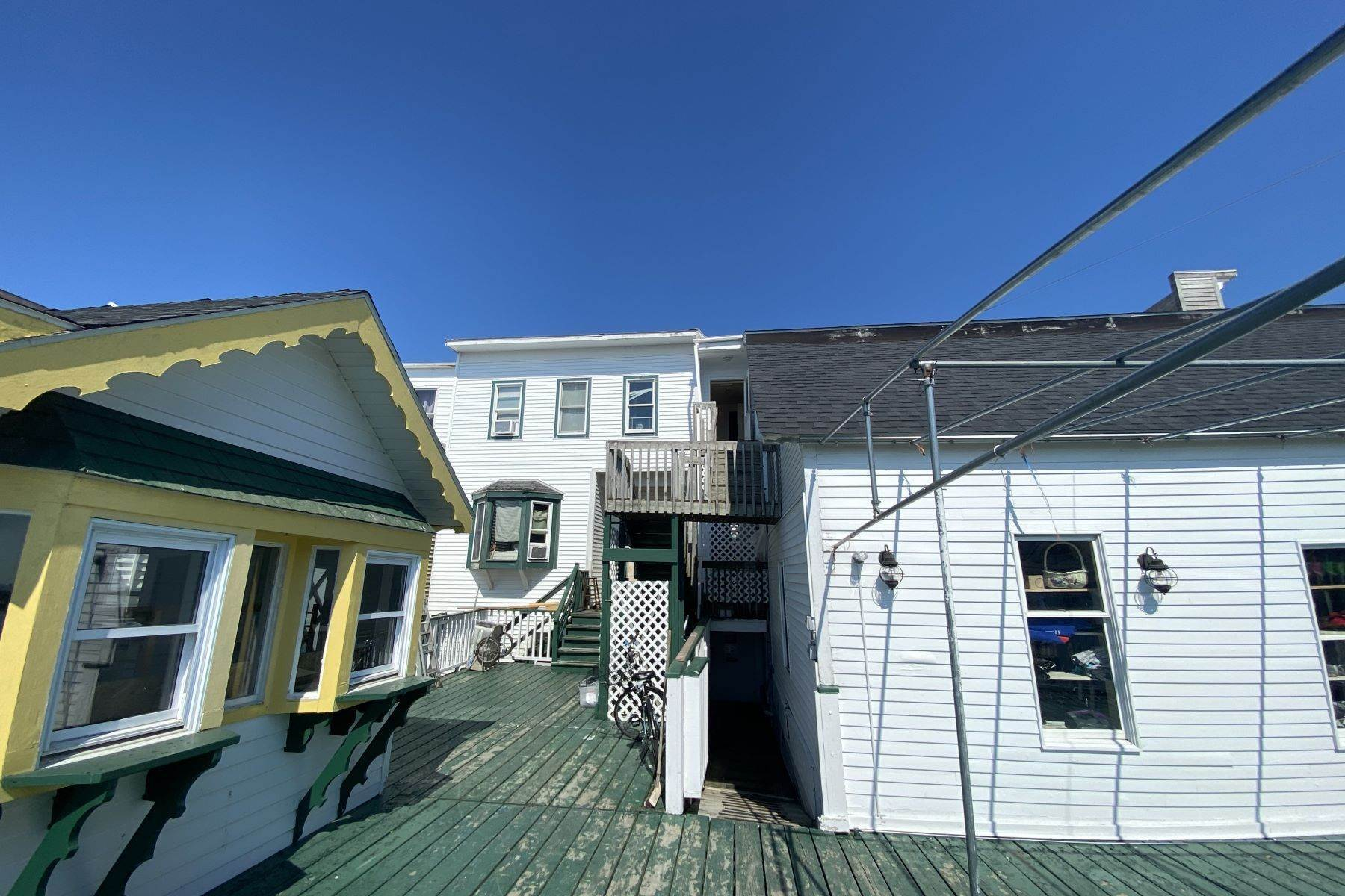 9. Commercial for Sale at Waterfront commercial building on Mackinac Island with retail space 7293 & 7279 Main Street Mackinac Island, Michigan 49757 United States