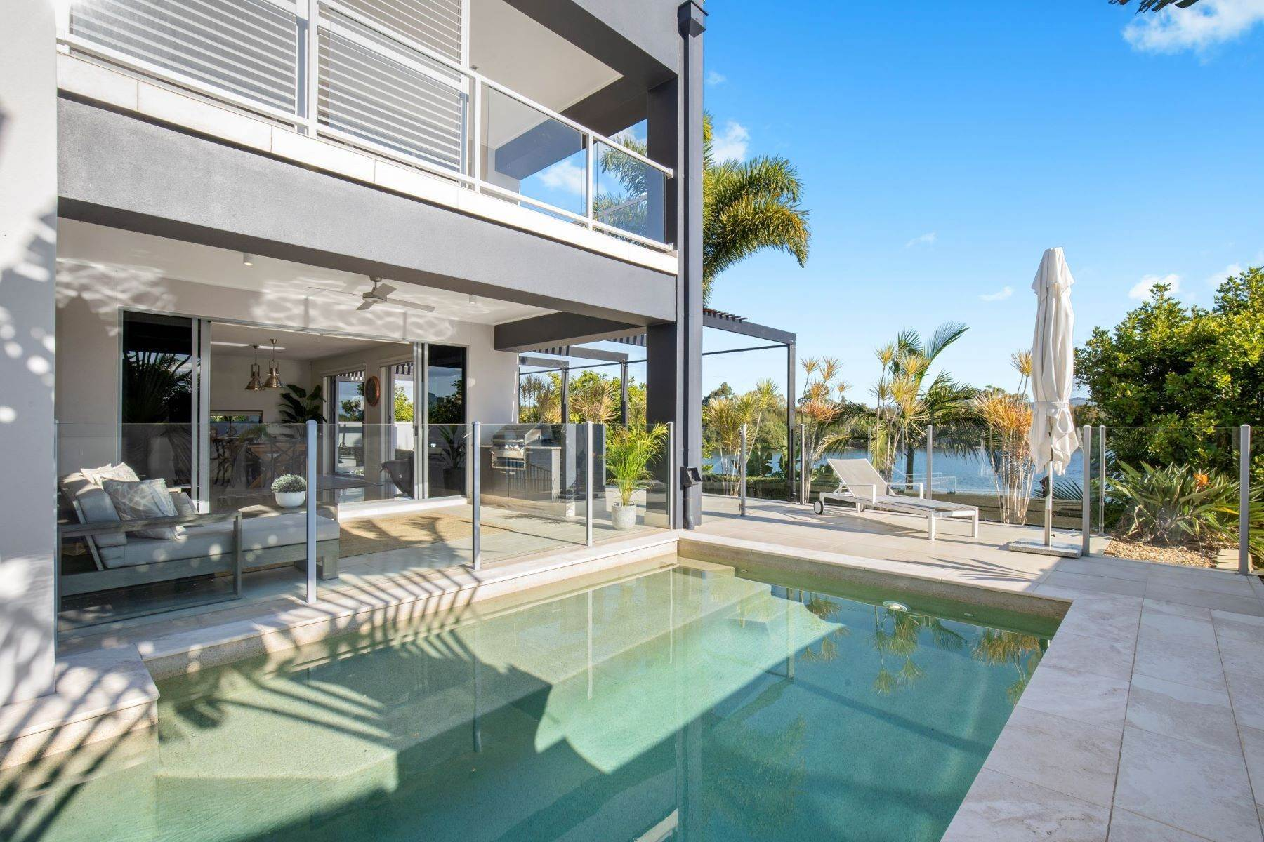 Single Family Homes for Sale at Luxury Lakeside Family Home on Prestigious Emerald Island 5068 Emerald Island Drive Other Queensland, Queensland 4211 Australia