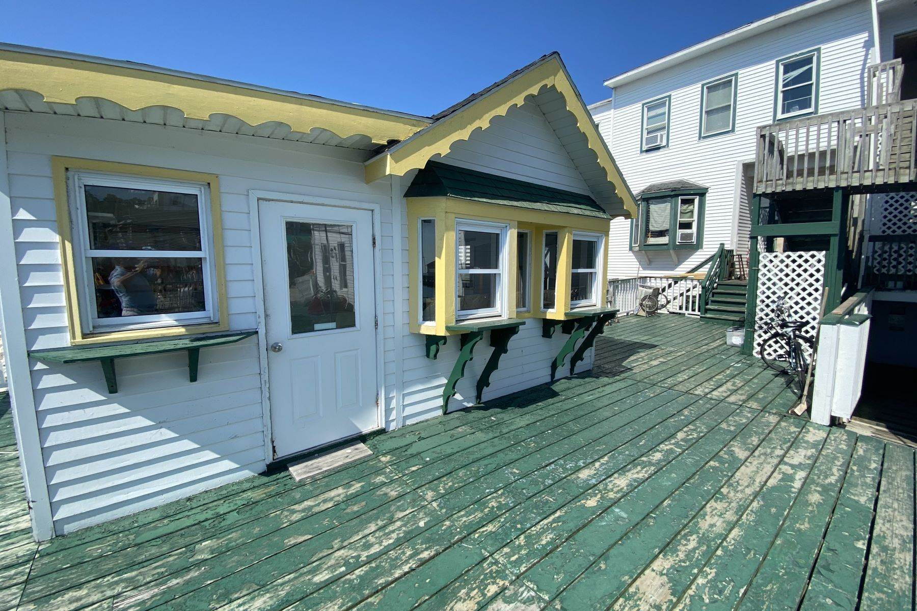7. Commercial for Sale at Waterfront commercial building on Mackinac Island with retail space 7293 & 7279 Main Street Mackinac Island, Michigan 49757 United States