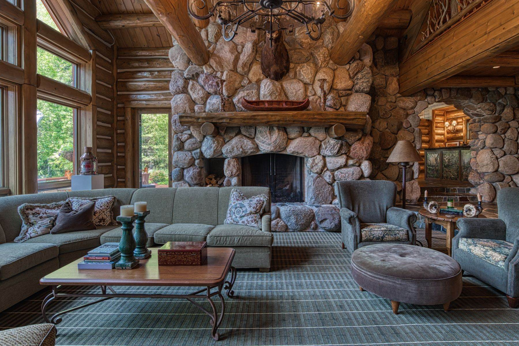 19. Single Family Homes for Sale at Incomparable custom log home on Lake Charlevoix 03080 Tall Pines Boyne City, Michigan 49712 United States