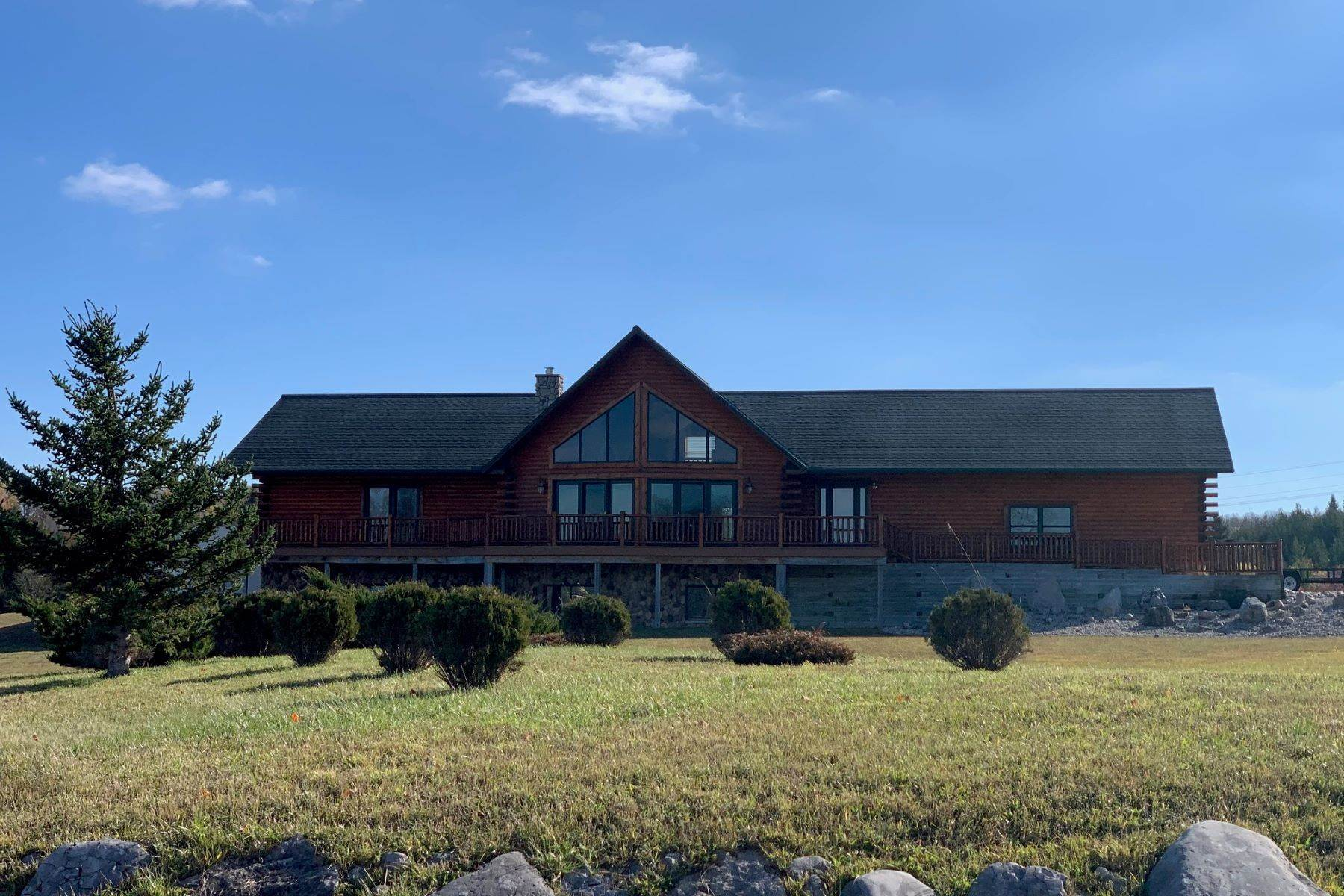 Single Family Homes for Sale at Inviting and attractive custom-crafted log home 1555 Lake Grove Petoskey, Michigan 49770 United States