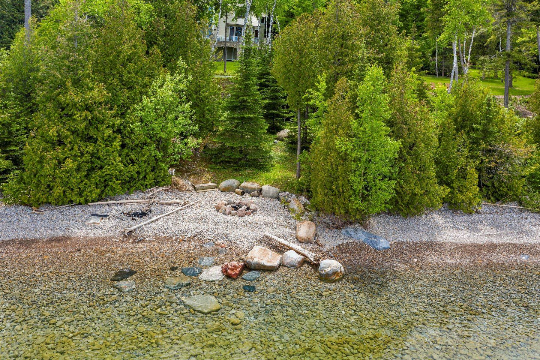 45. Single Family Homes for Sale at Private Lake Michigan Estate 6744 Preserve Drive North Bay Harbor, Michigan 49770 United States