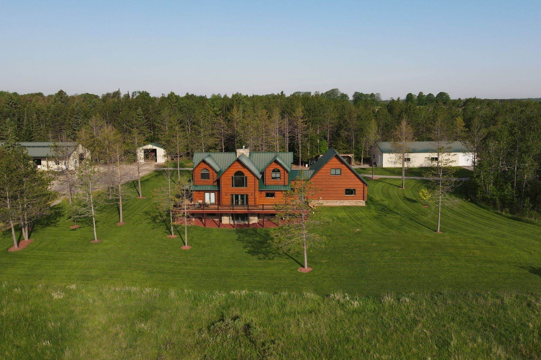 Single Family Homes for Sale at Hiawatha log home and equestrian estate on 80 acres 14493 Werth Road Lachine, Michigan 49753 United States