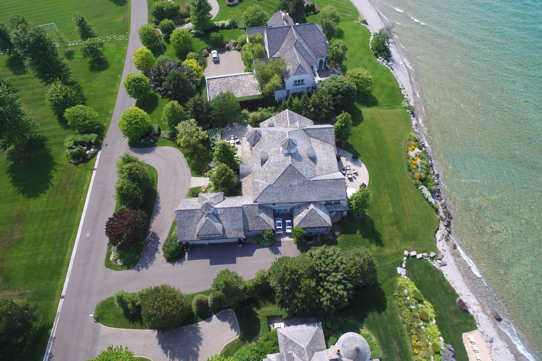 7. Single Family Homes for Sale at Custom-built estate on the gated Peninsula at Bay Harbor 3970 Peninsula Drive Bay Harbor, Michigan 49770 United States