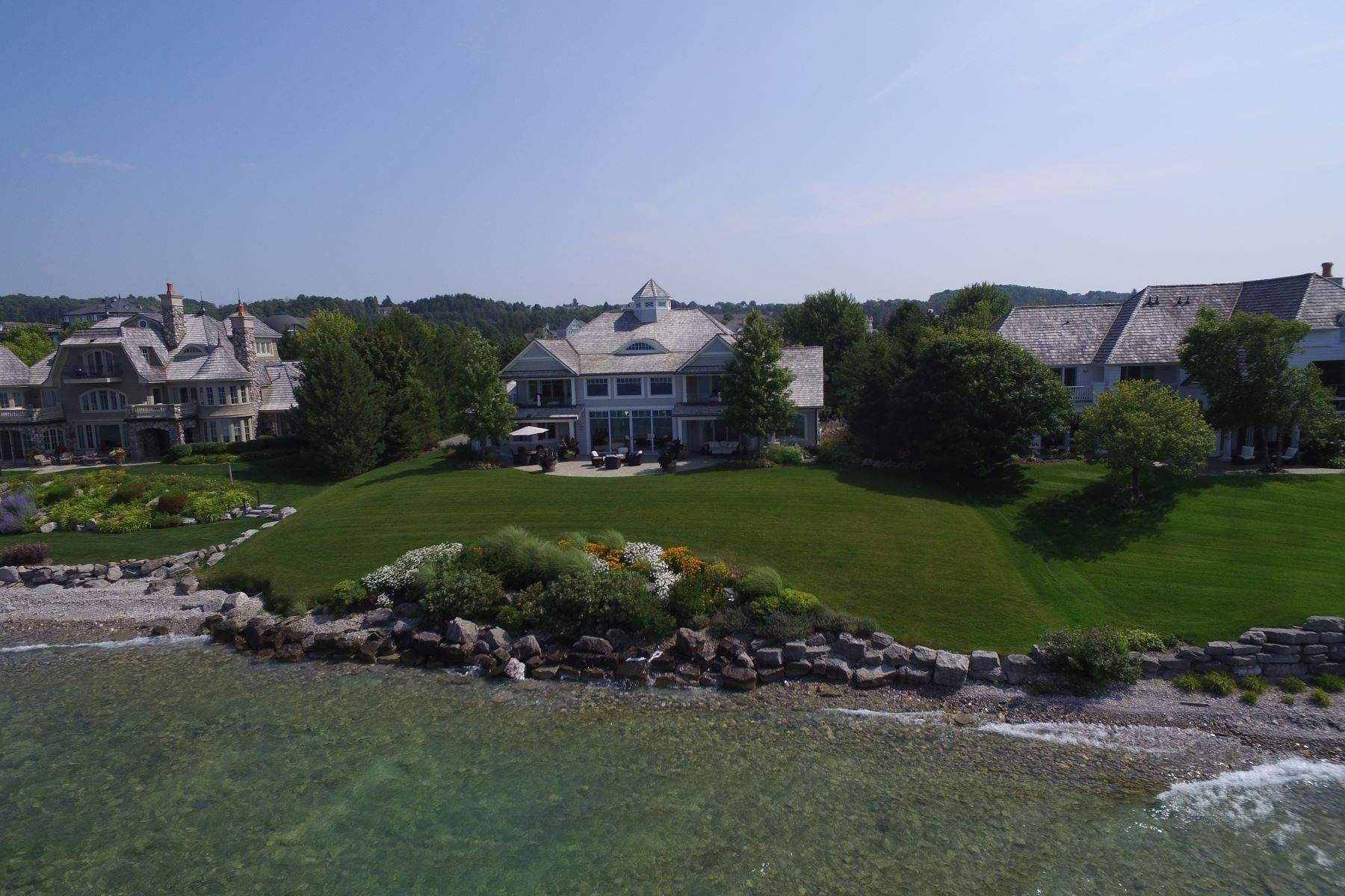 5. Single Family Homes for Sale at Custom-built estate on the gated Peninsula at Bay Harbor 3970 Peninsula Drive Bay Harbor, Michigan 49770 United States