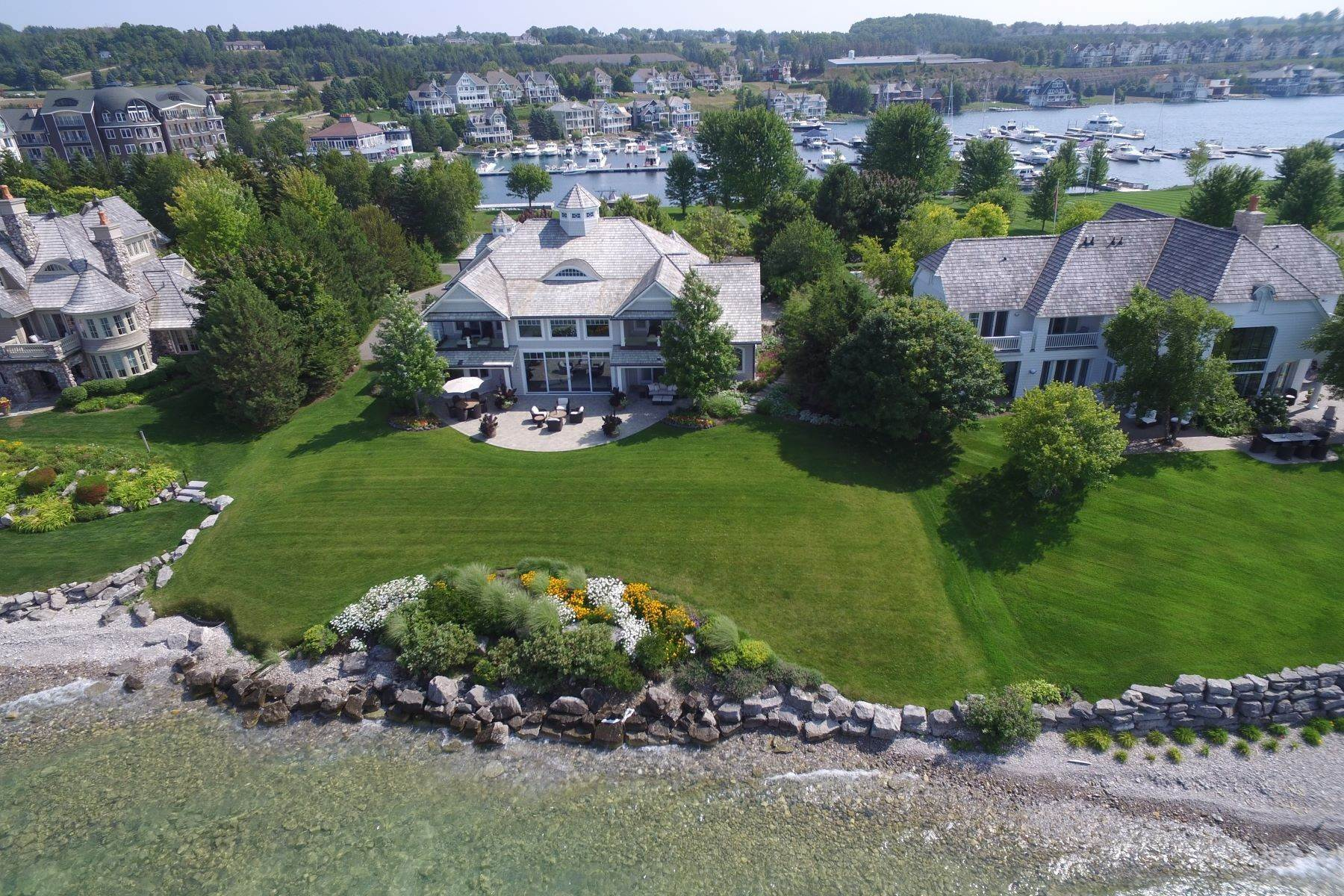 4. Single Family Homes for Sale at Custom-built estate on the gated Peninsula at Bay Harbor 3970 Peninsula Drive Bay Harbor, Michigan 49770 United States