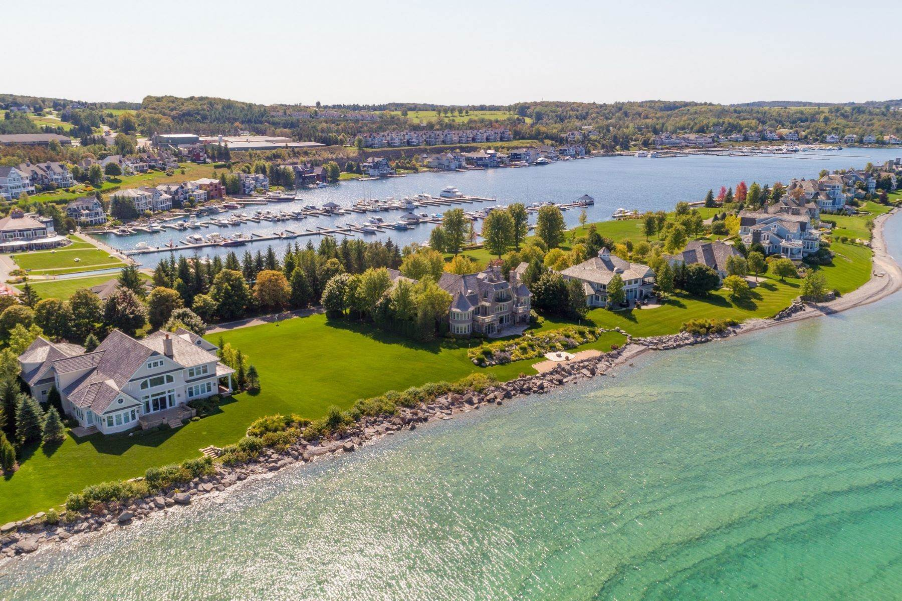 4. Single Family Homes for Sale at Grand and Inviting Waterfront Home 3910 Peninsula Drive Bay Harbor, Michigan 49770 United States